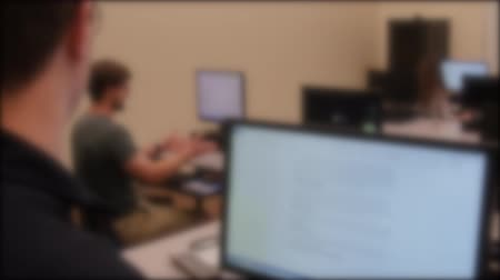 teste : Professor teaching in the computer lab at a university Stock Footage