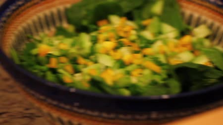 chop up : putting yellow peppers on a salad Stock Footage