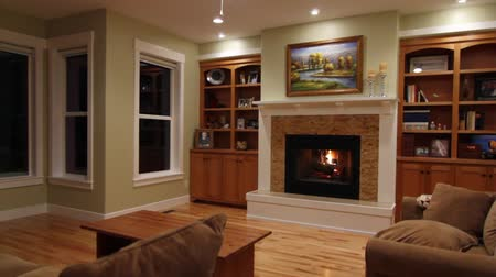 sitting room : a jib shot of a cozy fireplace and mantle in a beautiful sitting room Stock Footage