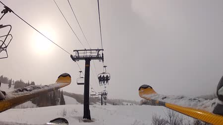 chair lift : skiers on lift Stock Footage