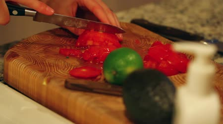 chop up : slicing tomatos for salad Stock Footage