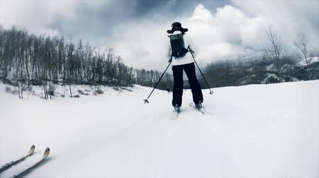 narciarz : slow motion shot of downhill skiing on a mountain ski resort