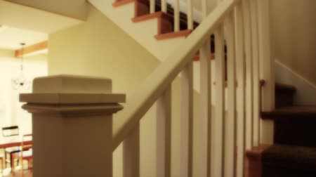 schody : A dolly shot of carpeted stairs in a new home Wideo