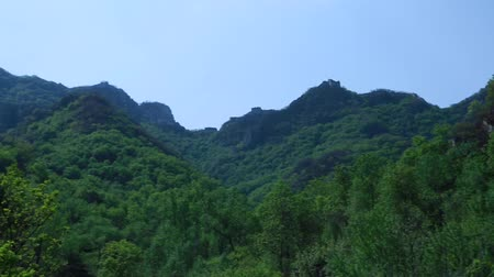 mutianyu section : the great wall of china on the mountain ridge