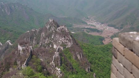 mutianyu section : the towers of the great wall of china on a mountain ridge