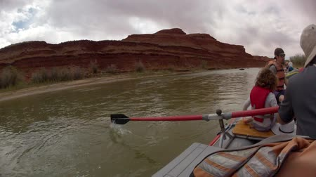 preserver : families running the san juan river in southern utah on river rafts through the desert timelapse Stock Footage