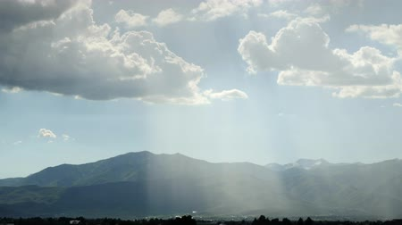 alpy : Timelapse beautiful rays of sun over mountain range