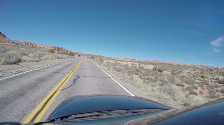 autó : Timelapse of driving car at Arches National Park Stock mozgókép