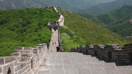 great wall of china : tourists hiking along the great wall of china jiankou section