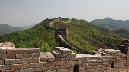 mutianyu section : tourists hiking the incredible section of great wall of china beijing mutiany