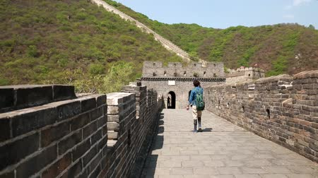 great wall of china : tourists on the incredible section of great wall of china beijing mutianyu