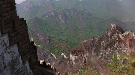 mutianyu section : towers and the great wall of china on a mountain ridge