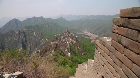 mutianyu section : towers of the great wall of china on a mountain ridge