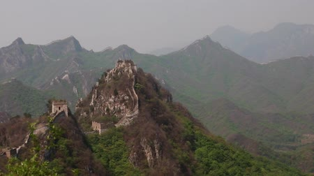 mutianyu section : towers on the great wall of china on a mountain ridge Stock Footage