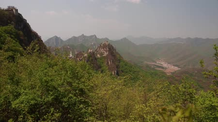 mutianyu section : towers on the great wall of china on mountain ridge