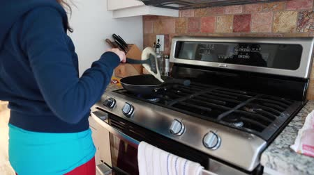fry : woman cooking a fresh tortilla in pan Stock Footage