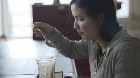 milk shake : A woman drinks a healthy shake for breakfast