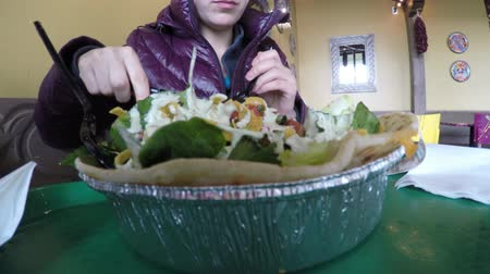 avokado : People stand in a line to order there food in a mexican restaurant
