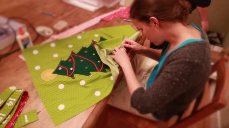 szycie : a woman hand sews a christmas advent calendar