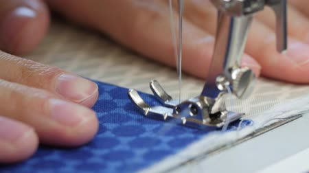 vyšívání : Woman sewing fabric with sewing machine close up Dostupné videozáznamy