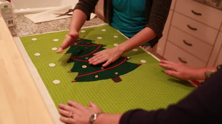 szycie : women make christmas advent calendar for craft time