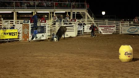 sportowiec : bull rider in slow motion at a prca professional rodeo