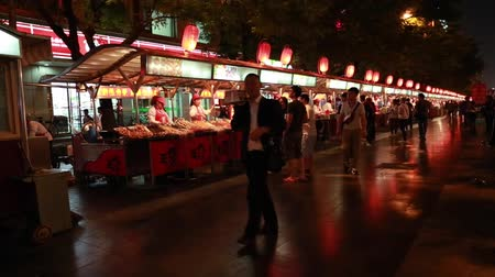 нездоровое питание : people buying food in an outside food market in downtown beijing china