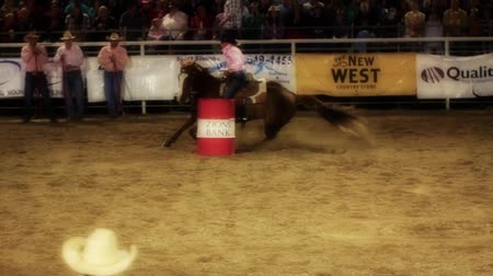 buty : Professional cowgirls barrel racing in a national PRCA rodeo