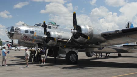 взрывной : Heber City, Utah - June 14 2015: An original B17 bomber and other aircraft at a World War II exhibit at the Heber City Airport Стоковые видеозаписи