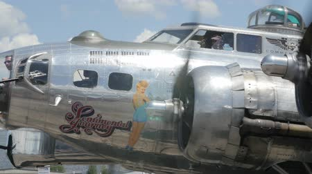 war : Heber City, Utah - June 14 2015: An original B17 bomber and other aircraft at a World War II exhibit at the Heber City Airport Stock Footage