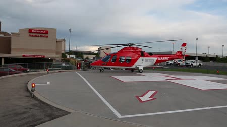 szpital : A life flight helicopter on a landing pad outside the hospital