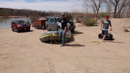preserver : a man blows up a river raft to go rafting