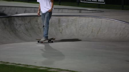 bmx : people at a skate park at nightime
