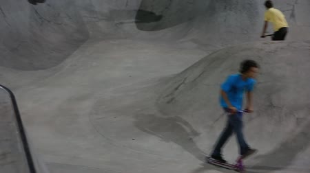 skate : people at a skate park at nightime