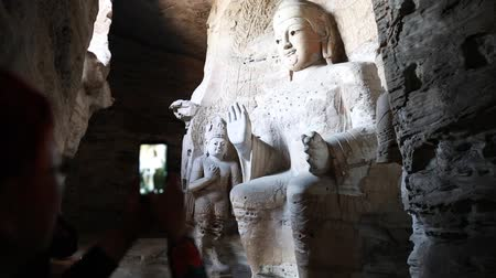 budha : the yungang grottoes in datong where buddhist sculptures can be found in caves.  now one of the unesco world heritage sites. Stock Footage