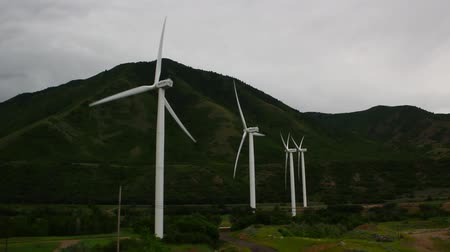 turbine : Windmills spinning in the wind creating green renewable energy