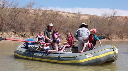 preserver : families running the san juan river in southern utah on river rafts through the desert Stock Footage