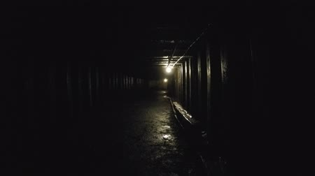 eixo : A deep tunnel inside dark coal mine at glace bay Stock Footage
