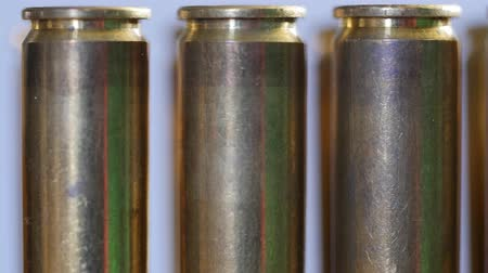 mass shooting : A Dolly shot of large caliber bullets in a production line