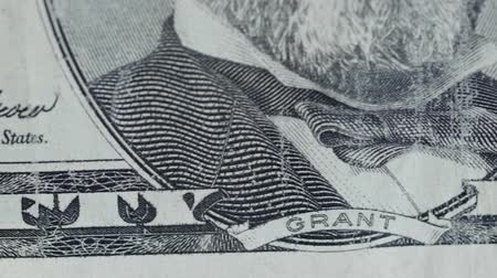zisky : A dolly shot of United States fifty dollar bill