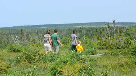 cape breton : A family walking through a nature reserve