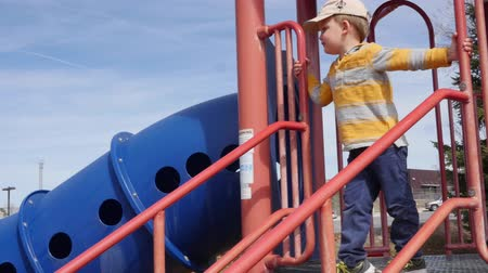 solo : A dolly shot of a boy playing at a park Stock Footage