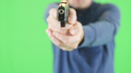 A green screen shot man with a 22 pistol