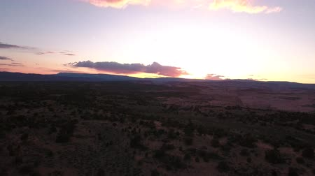 aventura : A jib aerial shot of a beautiful desert landscape and sunset