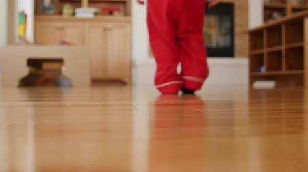 klapki : A little boy walks around house in pajamas and slippers