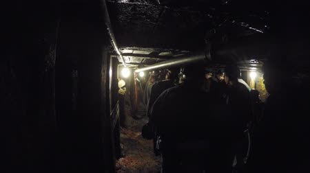 eixo : A shot through dark coal mine in glace bay with tourists families