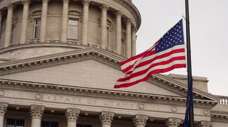 burocracia : A slow motion shot of flags at the Utah State Capitol Building
