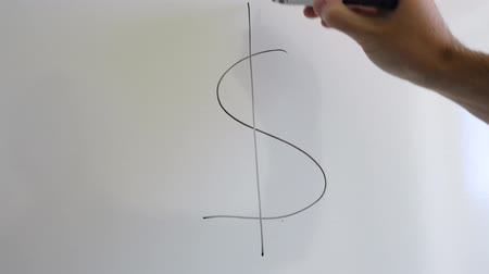 haladás : A small business ower draws dollar sign on whiteboard in meeting Stock mozgókép