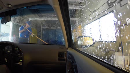 aeróbico : A timelapse from interior of a car as it is cleaned in a car wash Stock Footage