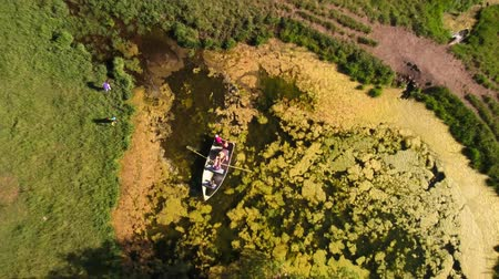 nagyapa : Aerial high shot of grandpa with his grand kids in row boat Stock mozgókép